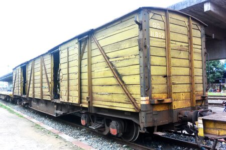 Yellow railway freight wooden wagon