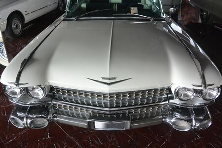 white old retro car Cadillac Fleetwood 1959 shot front and top in cambodia