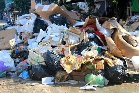 piles of garbage on city street close-up, Sihanoukville, Cambodia. Stock Photo