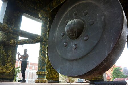 A Buddhist Giant Gong huge bronze gong in a buddhist temple Sihanoukville Cambodia