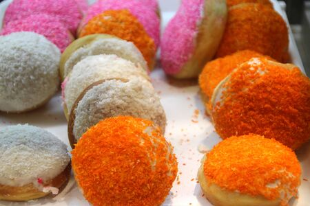 Multi-colored tasty donuts in a cafe window 1, Phnom Penh Imagens