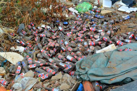 garbage on the side of the road beer bottles nature destruction human waste products cambodia southeast asia