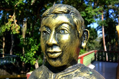 Monument to the Golden Boy at a Buddhist Temple, Sihanoukville, Cambodia