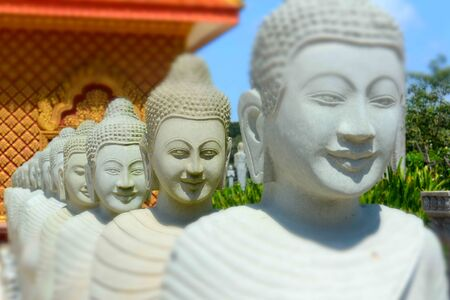 Stone sculptures of young monks, like-minded Buddha, Sin Temple, Sihanoukville, Cambodia, Southeast Asia