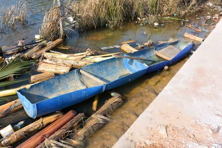 Homemade blue boat from two plastic barrels, Sihanoukville, Cambodia Stock Photo