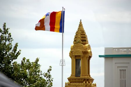 Buddhist flag on the background of the golden tomb, Phnom Penh, Cambodia 写真素材