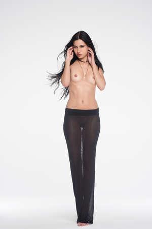Beautiful girl posing nude in black skirt