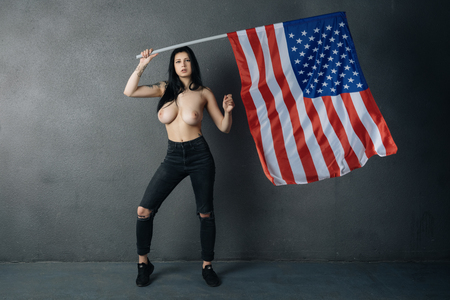 beautiful girl posing topless with American flag Stock Photo