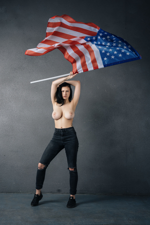 beautiful girl poses topless with american flag 写真素材
