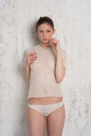 young girl posing in lingerie in studio