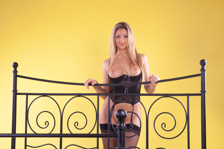 young beautiful girl posing nude in black lingerie Standard-Bild - 116849802