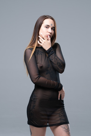 young beautiful girl in black transparent dress
