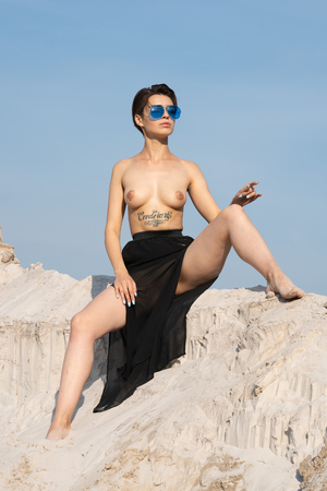 young beautiful girl posing nude from outside Standard-Bild - 121262652
