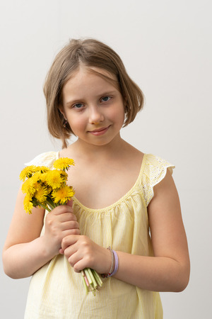 portrait of a little girl with yellow flowers Stock Photo
