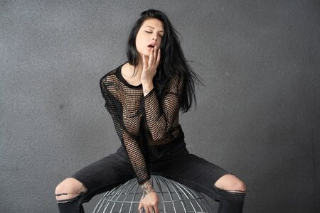 young beautiful girl posing in black