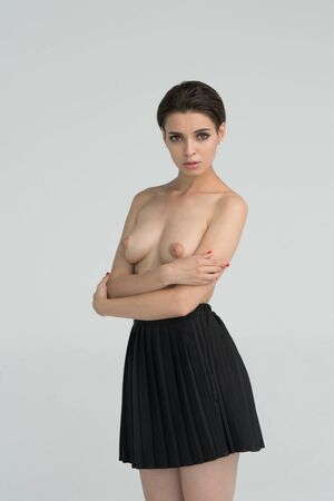 young beautiful girl posing nude in studio Фото со стока - 129295818