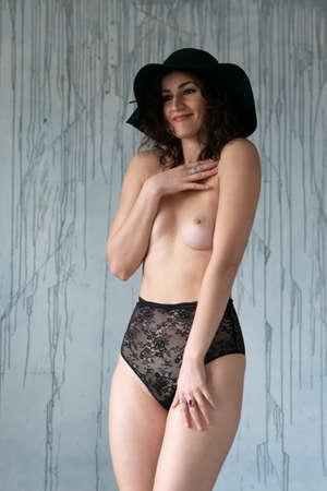 young beautiful girl posing in black lingerie in the studio Reklamní fotografie