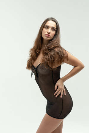 young beautiful woman posing in black lingerie in the studio Stock Photo