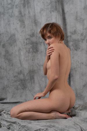 young beautiful woman posing in the studio