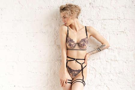 young beautiful woman posing in lingerie in studio