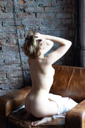 young beautiful woman posing nude in the studio