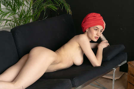 young beautiful woman posing nude, lying on the bed