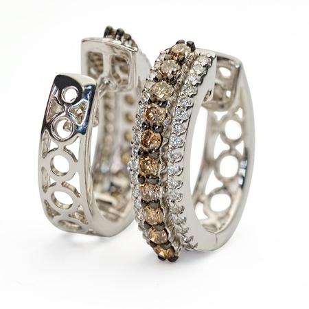 White gold diamond earings on white background.
