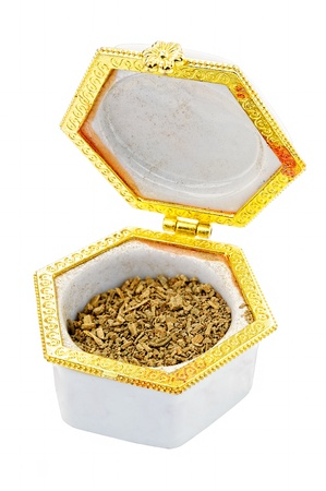 snuff: Snuff tobacco in a decorative porcelain snuffbox. Isoalted on white with clipping path. Stock Photo