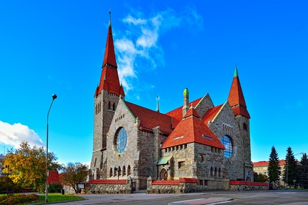 Medieval Tampere cathedral in Finland (Finnish Tampereen tuomiokirkko, Swedish Tammerfors domkyrka) is a church in Tampere, Finland and the seat of the Diocese of Tampere. The cathedral was designed by Lars Sonck and built between 1902 and 1907. Stock Photo