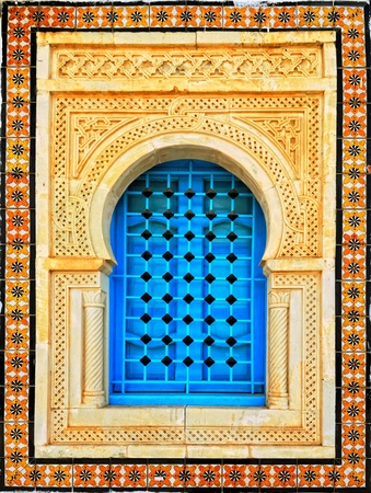 Decorated arabic style house window, Tunisia, Africa photo