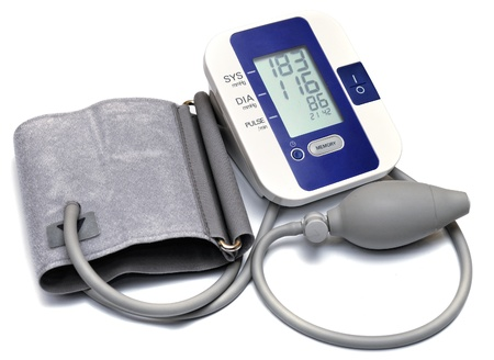 Close-up view to digital blood pressure manometer on white background.