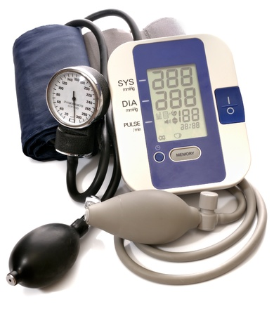 pressure: Close-up view to analog and digital blood pressure manometer on white background. Not isolated, studio shot Stock Photo