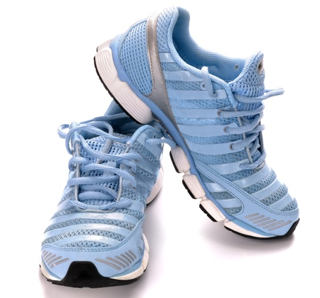A pair of new running shoes, all logos and markings removed. Studio shot on white, not isolated