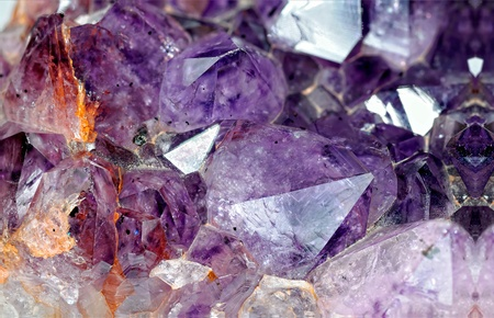 Close-up view to raw amethyst crystals. Studio shot with ring flash