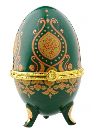 Decorative ceramic easter egg for jewellery (Faberge egg) against white background. photo