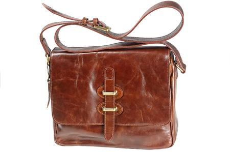 leren tas: Close-up op bruine dames leren tas tegen een witte achtergrond Stockfoto