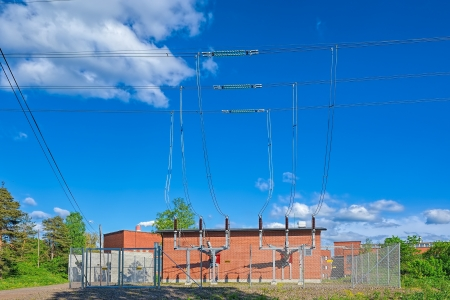 Electric power substation with high voltage connections against blue sky photo