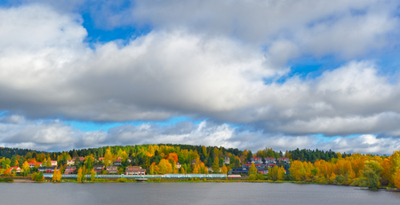 forest railroad: Autumn landscape with passenger train Stock Photo