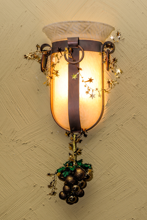 Wall lamp with Christmas decorations photo