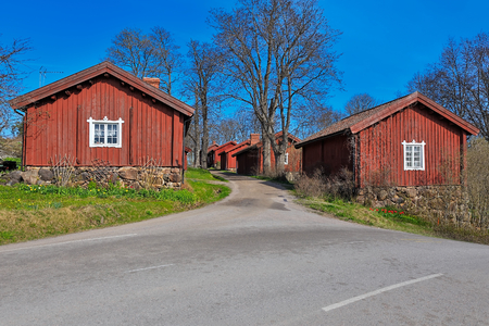 ironworks: Traditional red ochre painted colour wooden houses at Fagervik Ironworks works street, Finland. Most of the surviving huts date to the beginning of the 19th century.