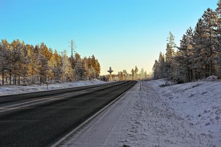 laden: Winter road with snow laden trees