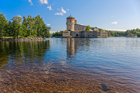 Medieval castle in the city of Savonlinna, Finland at summer photo