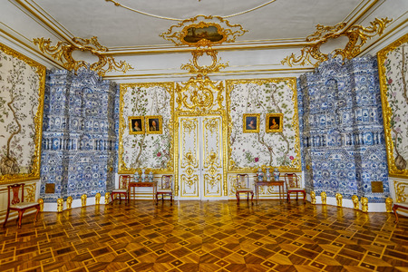 tiled stove: Ornate interior of the Catherine Palace with a multi-tiered tiled stove with cobalt painting. Tsarskoe Selo (Pushkin), St. Petersburg, Russia. Editorial