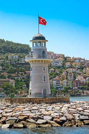 the middle: Lighthouse in port Alanya, Turkey. Stock Photo