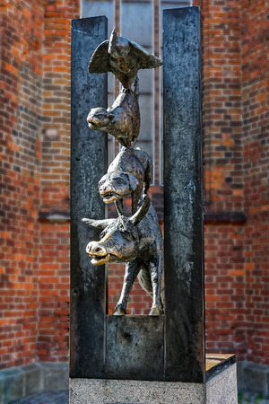 folk tales: Town Musicians of Bremens bronze statue in Riga, Latvia. It is based on a folk tale by the Brothers Grimm. The animals are: donkey, dog, cat and rooster.
