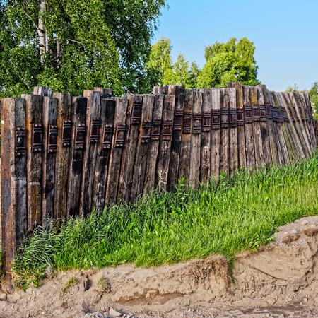 Fence made of old railway sleepers Stock Photo