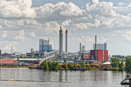 Industrial Paper Mill along a riverbank Stock Photo