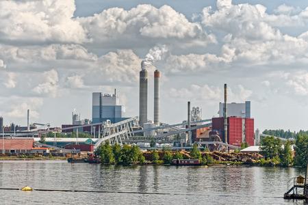 Industrial Paper Mill along a riverbank Stok Fotoğraf