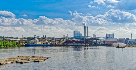 paper mill: Industrial Paper Mill along a riverbank Stock Photo