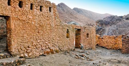 mountain oasis: Ruins of old houses in village Chebika, mountain oasis, Tunisia, Africa